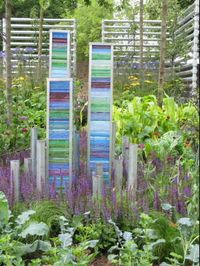 Recycled CD case tower in the Deptford Project garden at Hampton Court Flower Show 2011