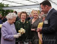 Her Majesty receiving Queen's Jubilee Rose from Beales' Roses at Chelsea Flower Show 2012