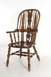 Carved wooden chair from Nigel Coope