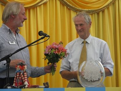 Phil Harkness presents Chris Warner with flowers, Hampton Court Flower Show 2014