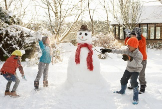 Shutterstock_54060898. Children and snowman