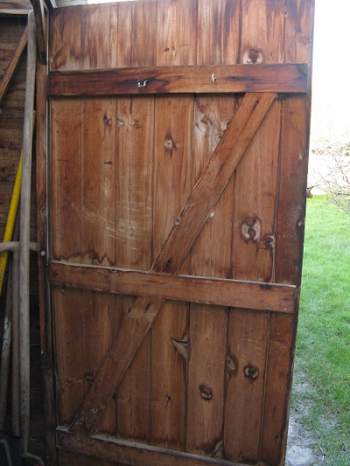 Wooden shed door with cross bracing