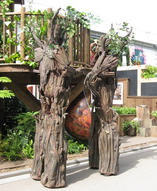 Tree people on stilts  Chelsea Flower Show 2017