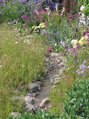 Squire's Garden Centres Urban Oasis, stream over pebbles, Hampton Court Flower Show 2015