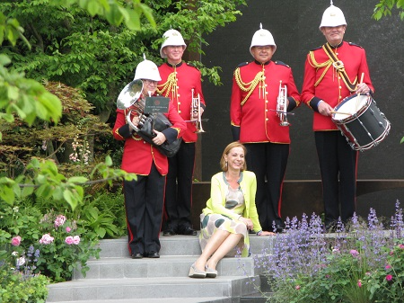 Jo Thompson with a military band in her Chelsea Barracks Garden.